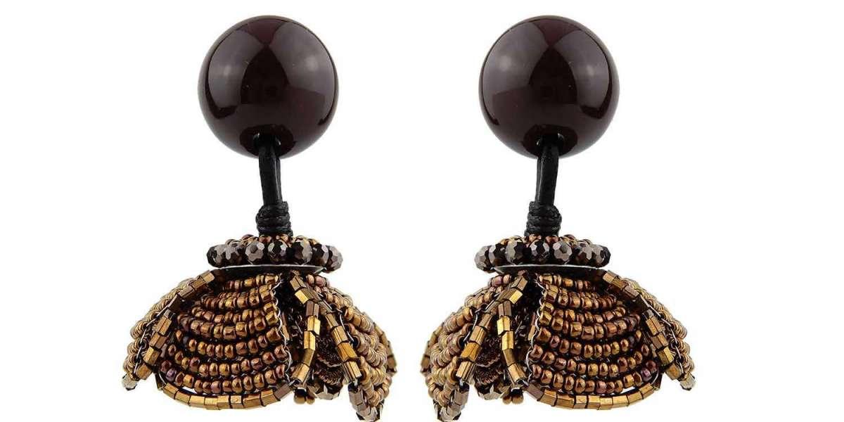 Asymmetrical Statement Earrings of Sea Snail